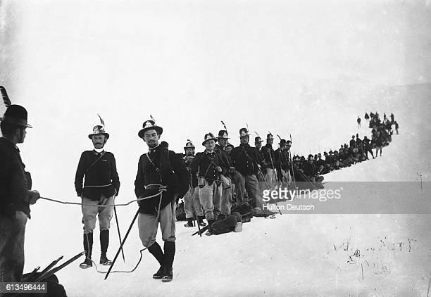 Men of an Italian alpine regiment on the Rurton glacier in the Alps during World War I
