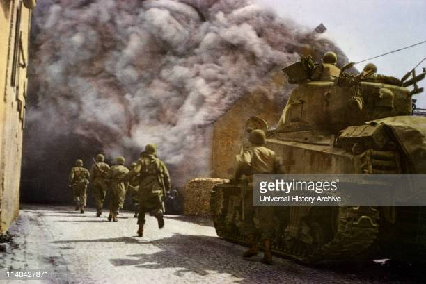Men of Armored Division Running Through SmokeFilled Street of German Town Central Europe Campaign Western Allied Invasion of Germany 1945