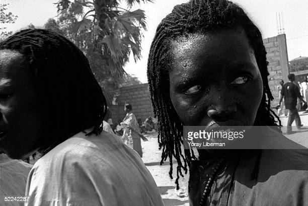Men of Baye Fall practice traditional rituals in Mbake during the Magal De Touba April 23 2003 in Mbake Senegal The Mouride Baye Fall community in...