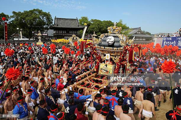 Men of Matsubara team carrying their Yatai or portable shrine arrive at the Matsubara Shrine on the first day of Nada Fighting Festival at the...
