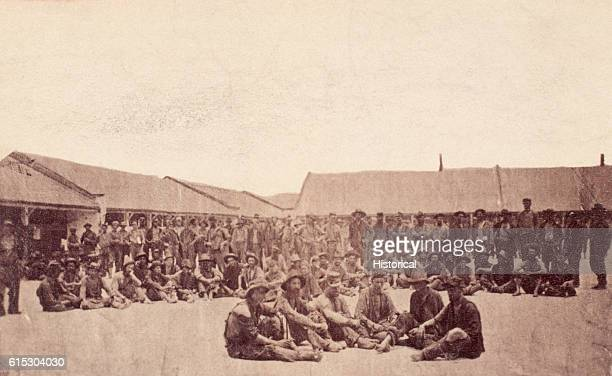 Men of the 19th Iowa Infantry pose in New Orleans Louisiana shortly after their release from the Confederate prisoner of war camp at Camp Ford Tyler...