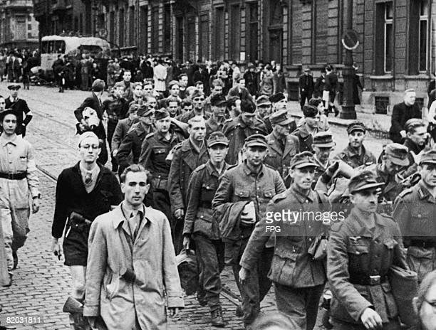 Men of the British Second Army march through liberated Brussels during World War II, 1944.