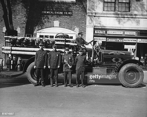 Men of the Chemical Engine Company No 1 pose with their fire engine circa 1925