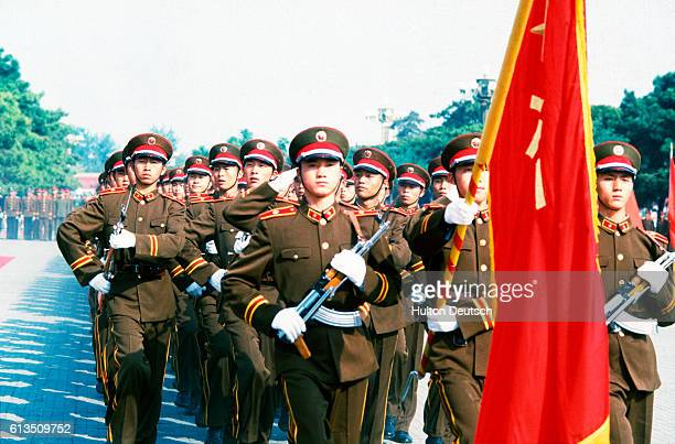 Men of the Chinese Army march past Queen Elizabeth II the first British monarch to visit China