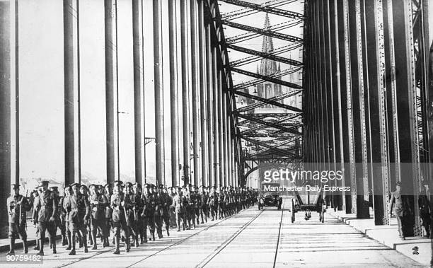 Men of the First Battalion Scots Guards marching over the Hohenzollern Bridge during the British occupation after the First World War In the distance...