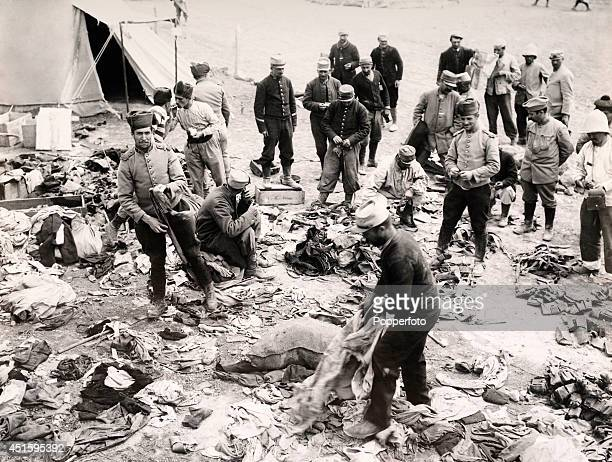 Men of the French Foreign Legion and Zouaves from Algeria at Camp Sedd el Bahr sorting out salvaged kit and equipment during the Gallipoli Campaign...