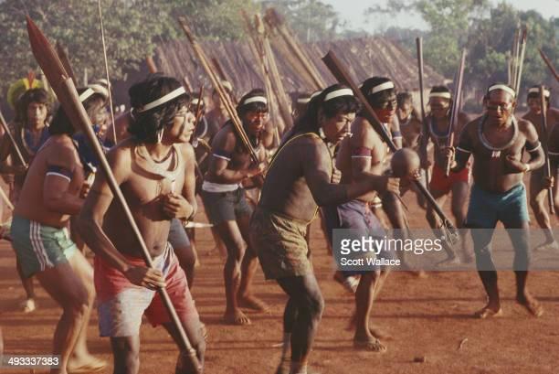 Men of the Kayapo people perform a war dance in the Amazon Basin Brazil 1992