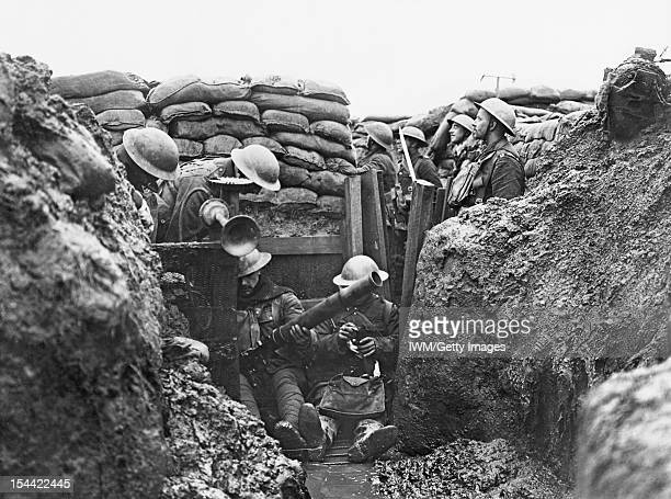 Men Of The Lancashire Fusiliers On The Western Front Near Messines Belgium C 1917 Men of the Lancashire Fusiliers sit in a muddy puddle on the floor...