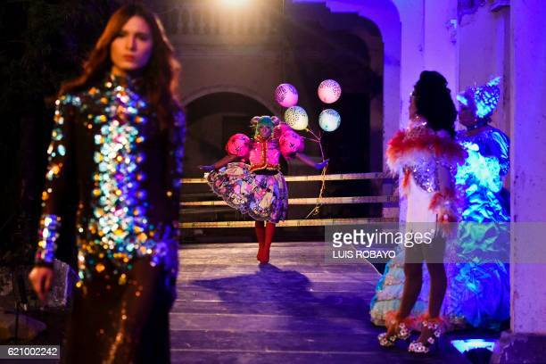 Men of the LGBTI community model creations by Colombian designer Diego Morales during the Walkway Inclusion fashion show in Cali Colombia on November...