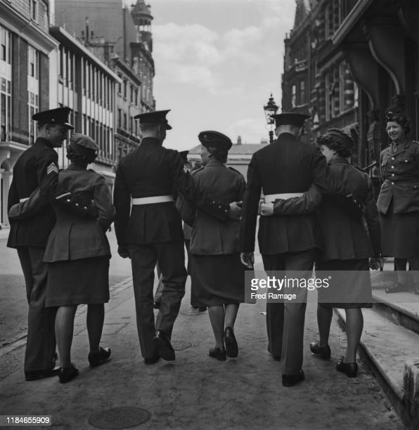 Men of the United States Marine Corps with their dates in London during World War II, August 1941.