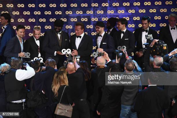 Men of the year Simon Verhoeven Thom Browne Gregory Porter Arnold Schwarzenegger Mark Forster Johannes Huebl and David Gandy are seen at the end of...