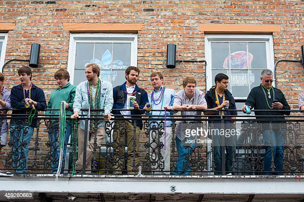 guys on balcony at mardi gras - miller lite stock pictures, royalty-free photos & images