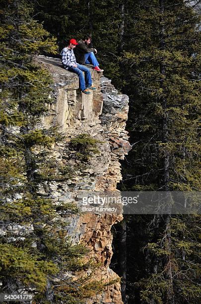 men on a cliff - only men stockfoto's en -beelden