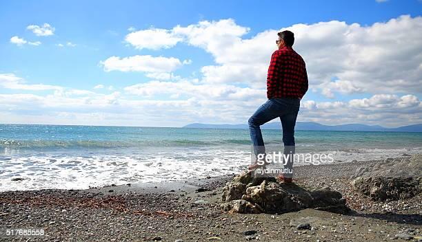 Men on autumn sea