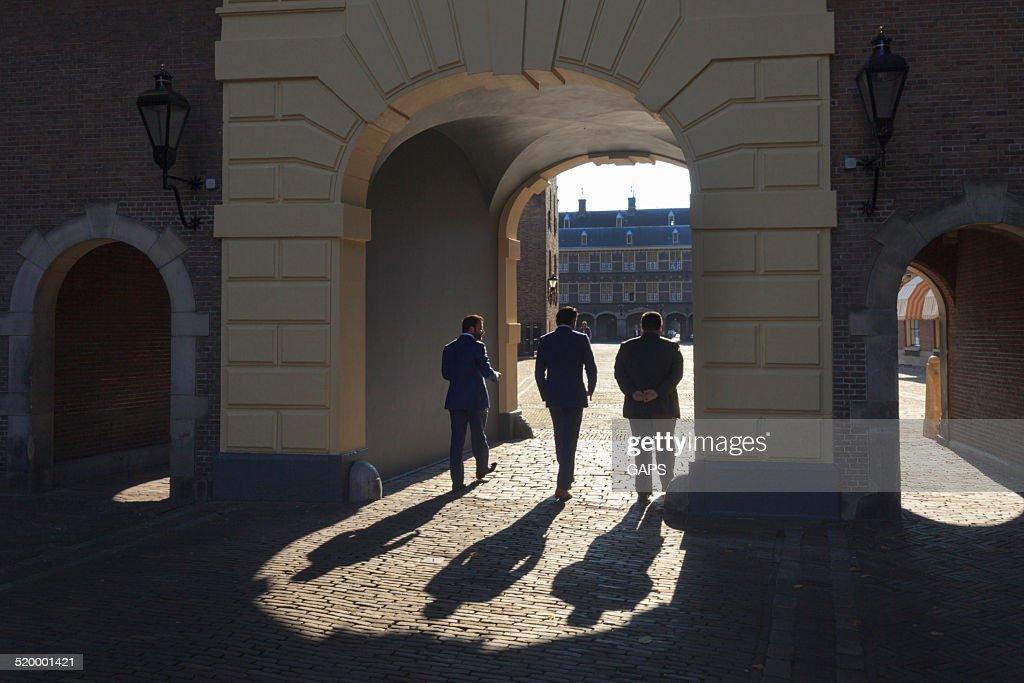 men on Binnenhof in The Hague : Stock Photo