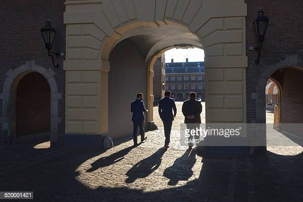 men on binnenhof in the hague - binnenhof stock photos and pictures