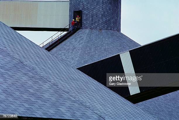 men on industrial rooftops - potash stock pictures, royalty-free photos & images