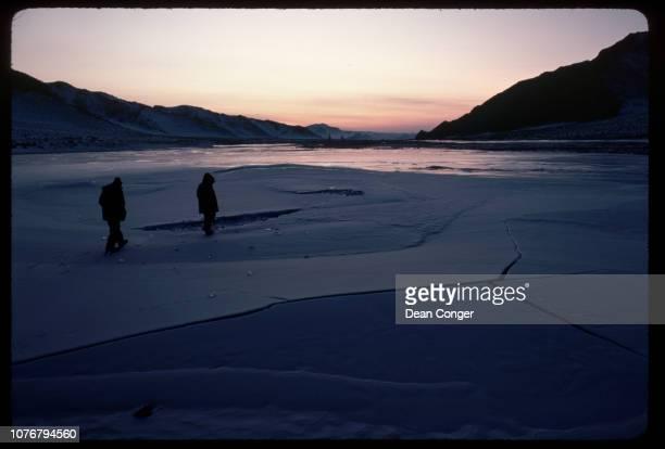 Men on River Ice at Dusk Mongolia
