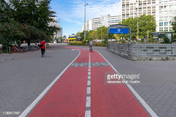 men on street in city - bicycle lane stock pictures, royalty-free photos & images