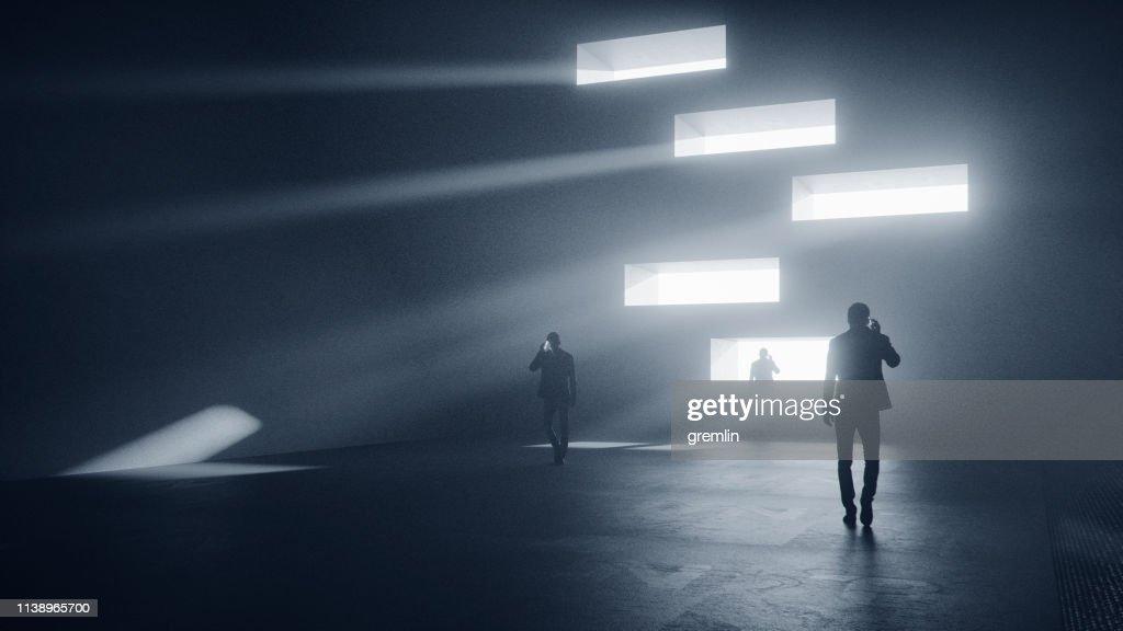 Men on the phone walking in dark, futuristic street : Stock Photo