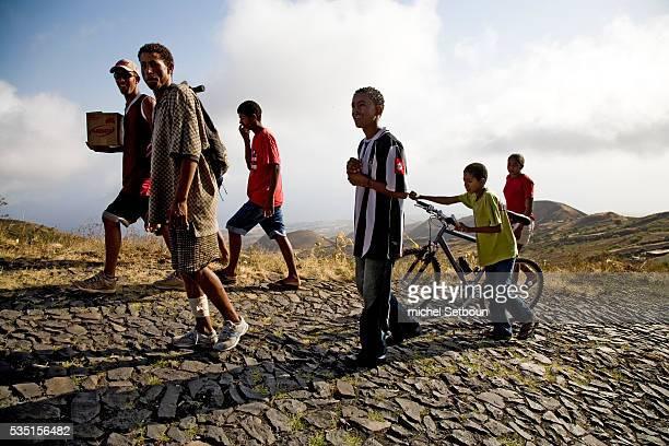 Men on the road to Fogo volcano on Fogo Island