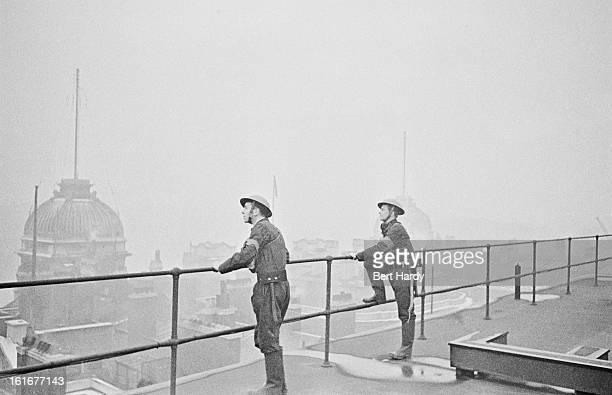 ARP men on the roof of Admiralty House on Whitehall in London the official residence of the First Lords of the Admiralty February 1941 Original...