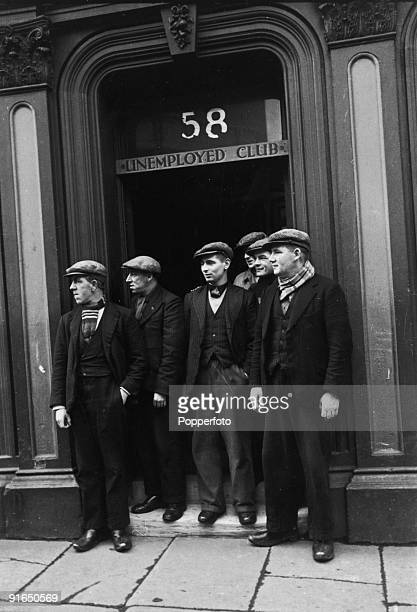 Men outside a club for the unemployed in Whitehaven, Cumbria, 1936.