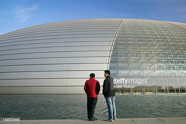 men outside the national center of performing arts, tiananmen square, beijing, china - only men stockfoto's en -beelden