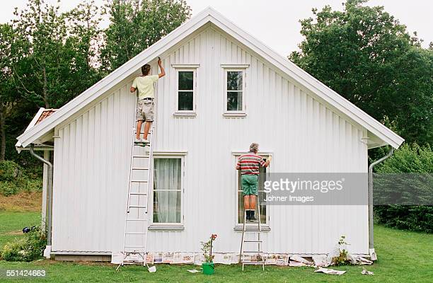 Men painting house