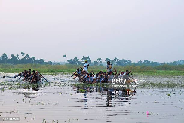 Men participate in a boat race in rural West Bengal.
