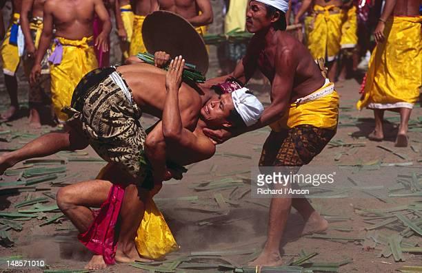 men participating in a fighting game at the usaba sambah festival. - only men stockfoto's en -beelden