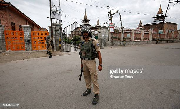 CRPF men patrol during the curfew hours on August 7 2016 in Srinagar India Kashmir has been reeling under violence curfew and separatists called...