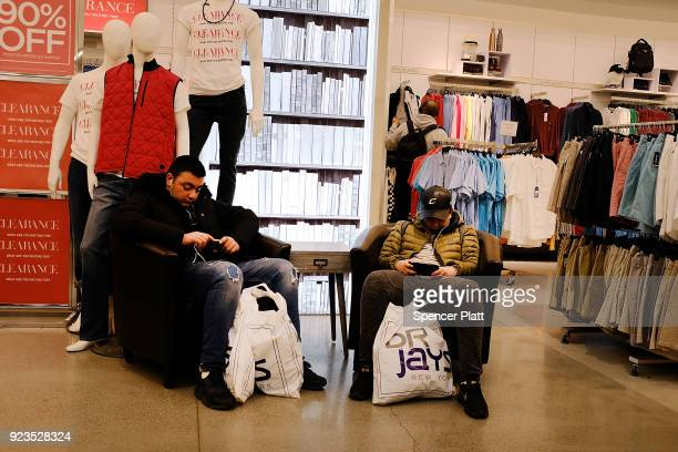 Men pause while shopping in a mall in downtown Brooklyn on February 23 2018 in New York City According to a new report released today by New York...