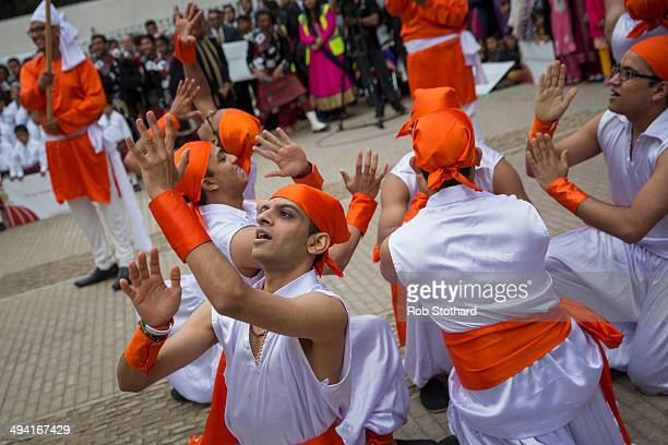 Men perform a traditional Indian dance for Mayor of London Boris Johnson at Shree Swaminarayan Mandir a major new Hindu temple being built in...