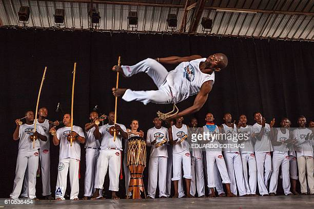 TOPSHOT Men perform during a presentation of the Capoeira for Peace project in Kinshasa on September 26 2016 / AFP / Eduardo SOTERAS