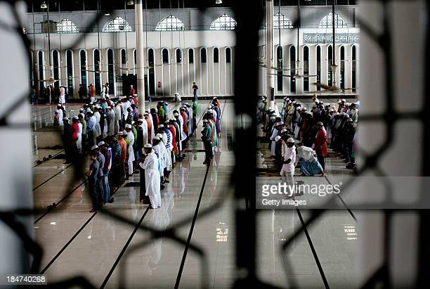 Men perform EidalAdha prayers at the National Mosque on October 16 2013 in Dhaka Bangladesh Eid AlAdha known as the 'Feast of the Sacrifice' is one...