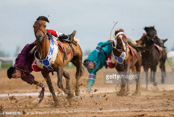 Men perform horse riding skills during the 6th Inner Mongolia International Equestrian Festival on July 27 2019 in Hohhot Inner Mongolia Autonomous...