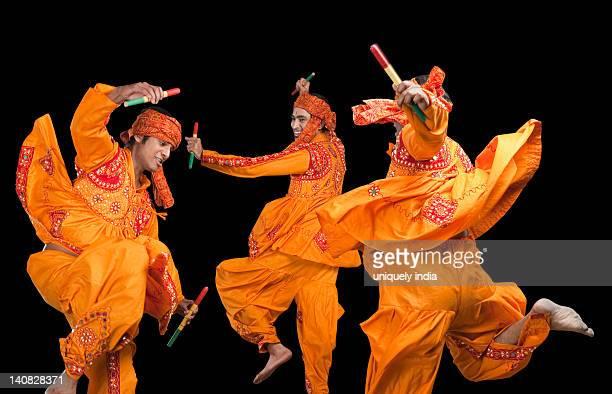 Men performing dandiya