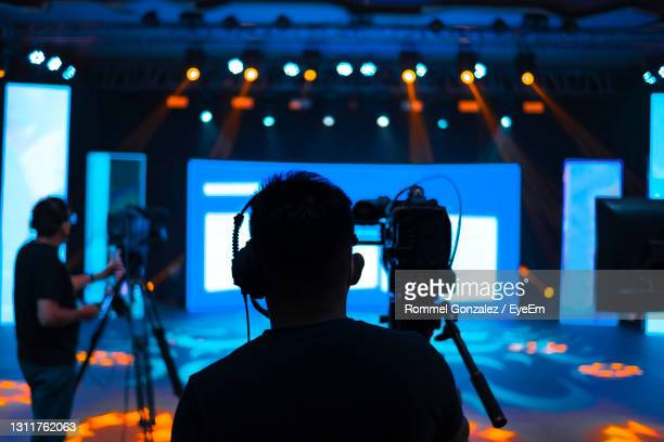 men photographing at music concert - television studio stock pictures, royalty-free photos & images
