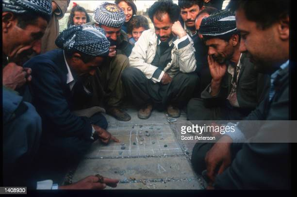 Men play a game April 16 1996 in Arbil Iraq Efforts by the Kurds to achieve autonomy or independence for the region have been resisted by both Turkey...