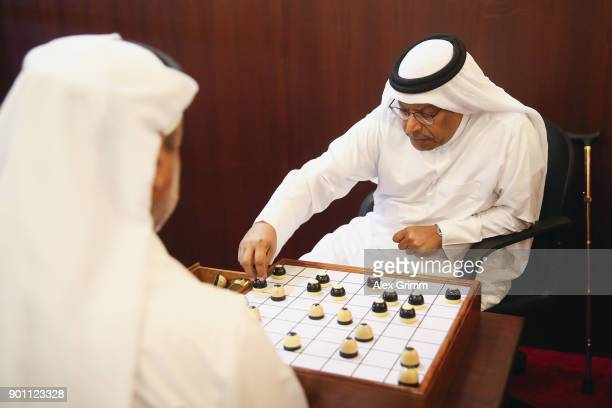 Men play Dama at the Majlis al Dama coffee shop at Souq Waqif during the FC Bayern Muenchen training camp on January 3 2018 in Doha Qatar