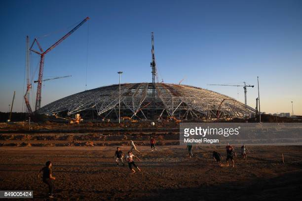 Men play football on the construction site of the Samara Arena on September 17 2017 in Samara Russia