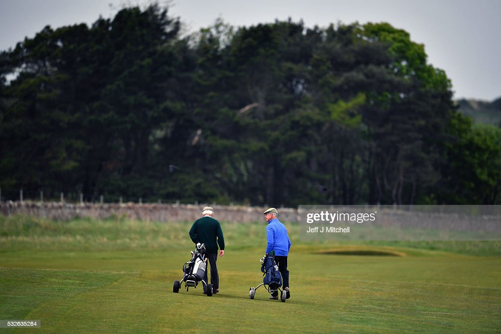 Men play golf at Muirfield Golf Club on May 19, 2016 in Gullane, Scotland. Muirfield Golf Club has lost the right to host the Open Championship after it failed to rally a majority of male members behind the vote allowing women to join the club as members. Women are welcome on the course and the clubhouse as guests and visitors.