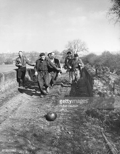 Men play in a traditional Shrove Tuesday football game in Ashbourne