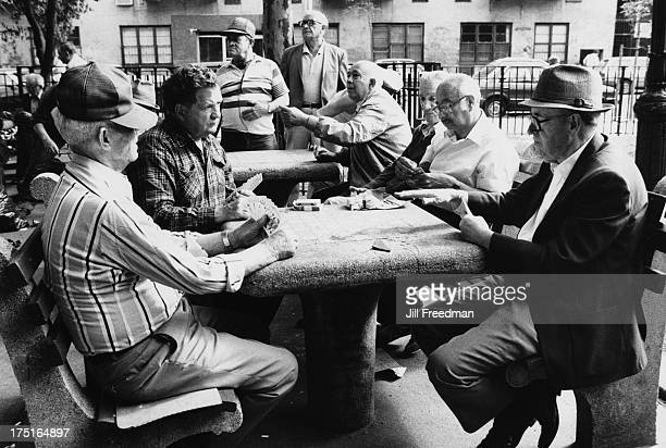 Men play poker outdoors at Tompkins Square Park New York City 1986