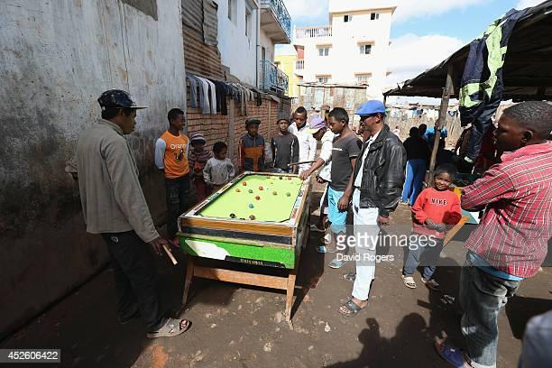 Men play pool in Antananarivo on July 21 2014 in Antananarivo Madagascar