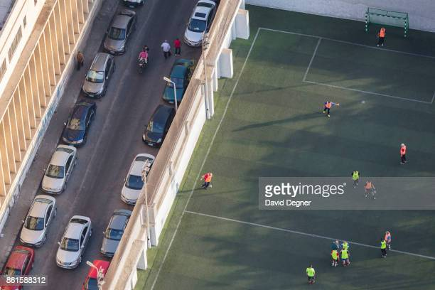 Men play soccer in a private club on Zamalek on September 24 2017 in Cairo Egypt Overview photos of Cairo's buildings cityscape and infrastructure...