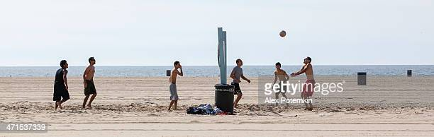 Men play volleyball on Venice Beach