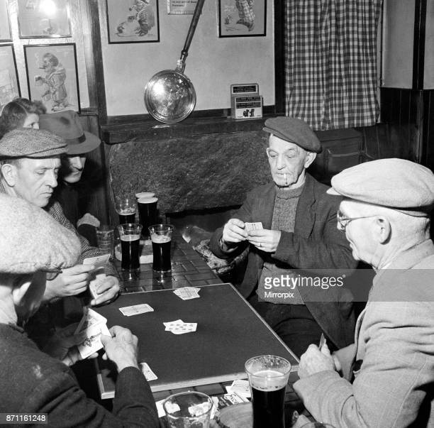 Men playing a game of Nap in 'The Sloop' Back Lane St Ives most ancient public house Cornwall 15th February 1954