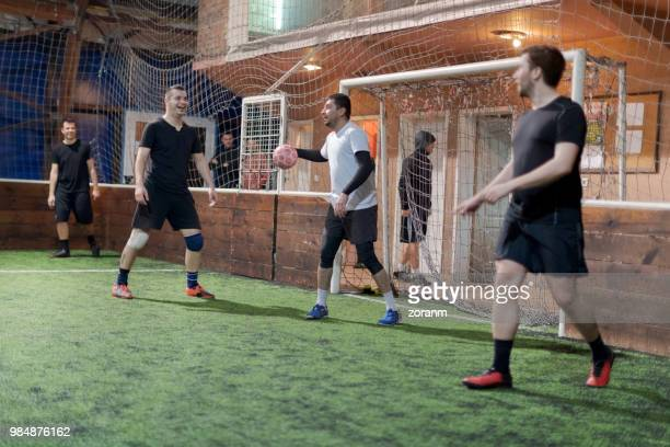 men playing amateur soccer indoors - amateur stock pictures, royalty-free photos & images